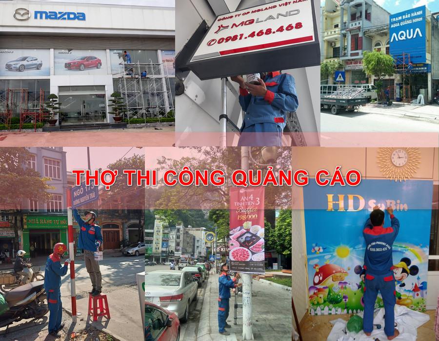 Nhân viên thi công quảng cáo làm việc tại Hạ Long